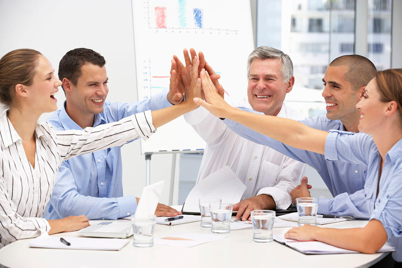 Five employees give each other a five