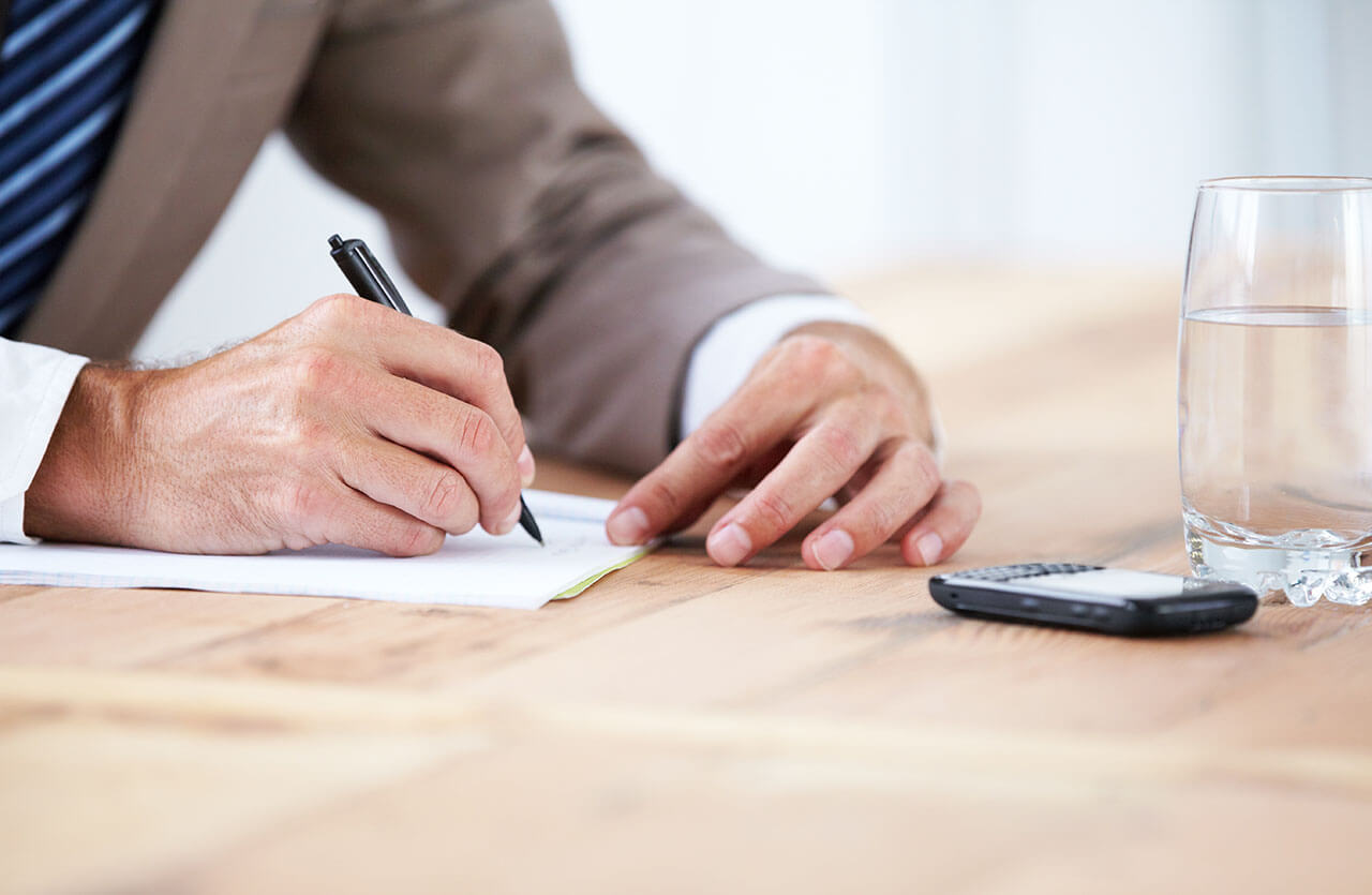 The man signs a document