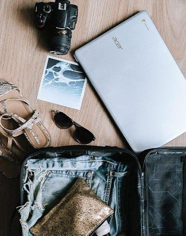 camera, laptop,suitcase